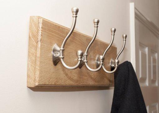 4 coat hooks on an Oak board.